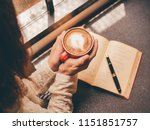 woman holding a coffee cup and... | Shutterstock . vector #1151851757