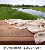 empty wooden deck table with... | Shutterstock . vector #1151877254