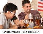 friends drinking beer in bar | Shutterstock . vector #1151887814