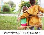children sitting on a swing in...   Shutterstock . vector #1151898554