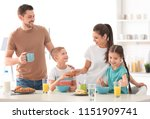 happy family having breakfast... | Shutterstock . vector #1151909741