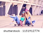 two fashionable skaters fooling ...   Shutterstock . vector #1151912774