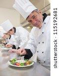 cheerful chef's preparing their ... | Shutterstock . vector #115192681