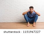 young natural man sit on a...   Shutterstock . vector #1151967227