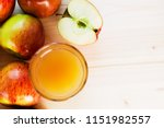 glass of fresh apple juice and... | Shutterstock . vector #1151982557