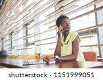 young beautiful african... | Shutterstock . vector #1151999051