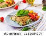 frittata with zucchini  cheese  ... | Shutterstock . vector #1152004304