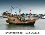 "Pirate ship with a lot of  ""kidnapped"" tourists onboard - stock photo"
