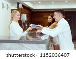 couple near reception desk in... | Shutterstock . vector #1152036407