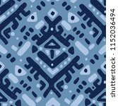ikat ornament. tribal pattern... | Shutterstock .eps vector #1152036494