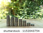 coin stacks on green background. | Shutterstock . vector #1152043754