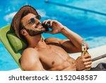 man in sunglasses talking on... | Shutterstock . vector #1152048587
