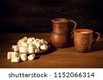 white marshmallow  clay jug and ... | Shutterstock . vector #1152066314