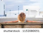 back of a girl sitting on a...   Shutterstock . vector #1152080051