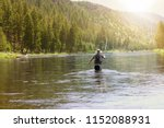 fisherman flyfishing in river... | Shutterstock . vector #1152088931