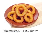 a plate with spanish calamares a la romana, squid rings breaded and fried - stock photo