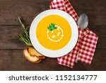 squash soup with parsley.... | Shutterstock . vector #1152134777
