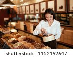 chocolate store. woman working... | Shutterstock . vector #1152192647