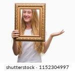 blonde teenager woman holding... | Shutterstock . vector #1152304997