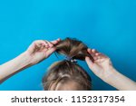 girl straightens the disheveled ...   Shutterstock . vector #1152317354