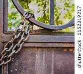 rusty chain at the gate | Shutterstock . vector #1152319217