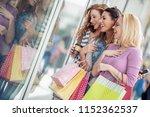 happy surprised young women... | Shutterstock . vector #1152362537