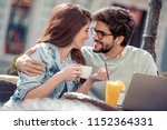 couple sitting at cafe and... | Shutterstock . vector #1152364331
