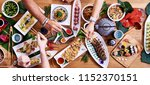 overhead view of friends eating ... | Shutterstock . vector #1152370151