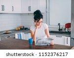 beautiful young woman reading... | Shutterstock . vector #1152376217