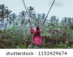 women sit on swings at a height ... | Shutterstock . vector #1152429674