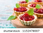 tartlets with strawberry jam... | Shutterstock . vector #1152478007