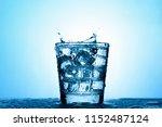 splash water in a clear glass... | Shutterstock . vector #1152487124