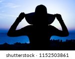 silhouette of a girl on a chair ... | Shutterstock . vector #1152503861