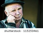 old man keeps his hand near the ... | Shutterstock . vector #115253461