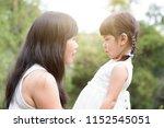 asian family outdoors portrait. ... | Shutterstock . vector #1152545051