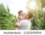 asian family outdoors portrait. ... | Shutterstock . vector #1152545054