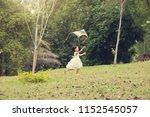 asian family outdoors activity. ... | Shutterstock . vector #1152545057