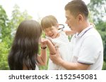 happy parents and child having... | Shutterstock . vector #1152545081