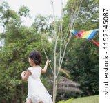 asian family outdoors activity. ... | Shutterstock . vector #1152545087