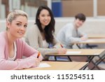 students looking up from exam... | Shutterstock . vector #115254511