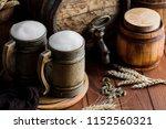 light foam beer in a glass on... | Shutterstock . vector #1152560321