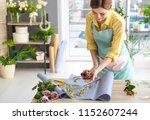 female florist creating bouquet ... | Shutterstock . vector #1152607244