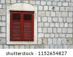 old window shutter in ston ... | Shutterstock . vector #1152654827
