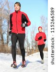 Sport in winter - People running in snow. Man and woman fitness couple. - stock photo