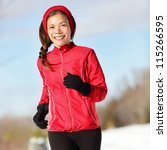 Fitness running woman. Closeup of female runner training and jogging outdoors in winter snow. Wellness workout and healthy lifestyle concept with mixed race Asian / Caucasian female fitness model. - stock photo