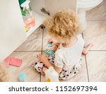 unattended girl child play... | Shutterstock . vector #1152697394