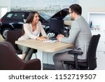 sales manager at a showroom car ... | Shutterstock . vector #1152719507