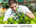 Young Male Gardener Working In...