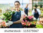happy female nursery owner with ... | Shutterstock . vector #115275067