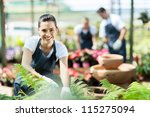 happy female nursery worker... | Shutterstock . vector #115275094